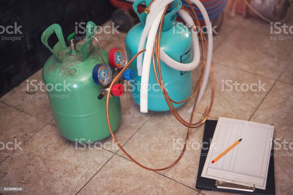 Freon gas balloons with pressure meter stock photo