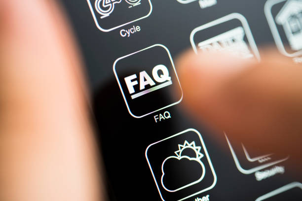Frequently asked questions app logo on dark mode phone screen stock photo