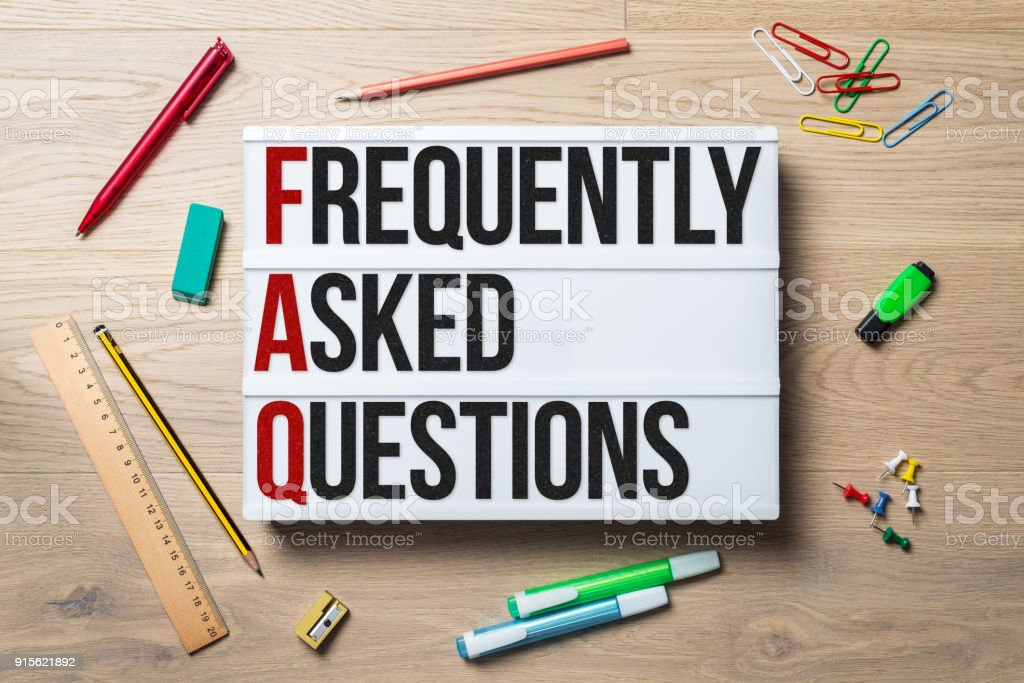Frequently asked questions written on lightbox lying on desk stock photo