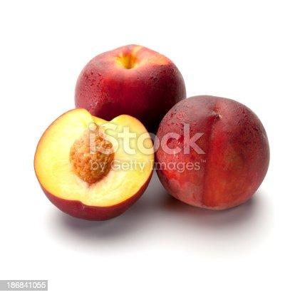 Fresh peaches isolated on white.