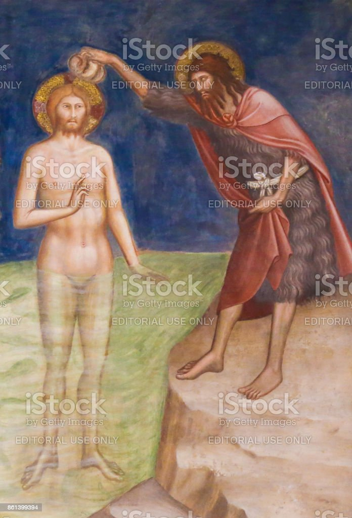 Fresco in San Gimignano - Baptism of Jesus Christ stock photo