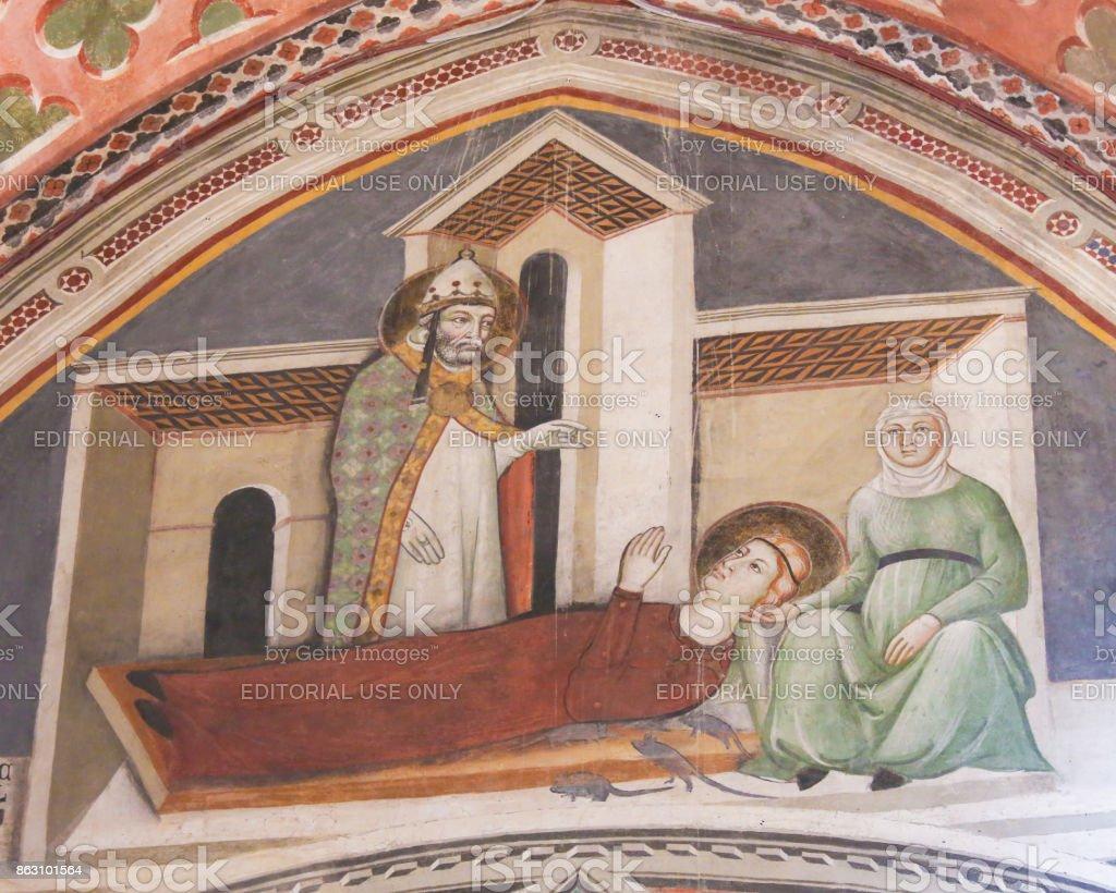 Fresco in San Gimignano - Saints Gregory and Fina stock photo
