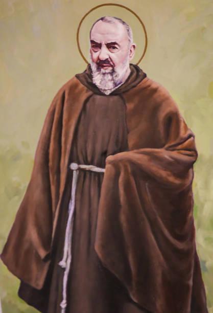 Fresco of Padre Pio in Valencia Fresco in the Church of Saint Nicholas in Valencia, Spain, of Padre Pio or Saint Pio of Pietrelcina, famous Italian friar, priest, stigmatist, and mystic. religious saint stock pictures, royalty-free photos & images