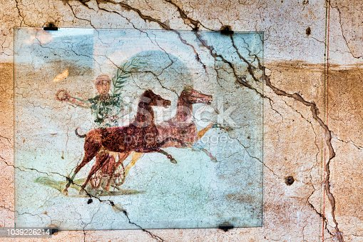 Fresco with the Aurighi in a corridor of the Aurighi tenement in the archaeological excavations of Ancient ostia - Rome