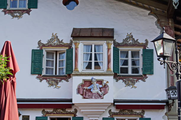 Frescoes painting at the pedestrian zone of Oberammergau. Bavaria, Germany. stock photo