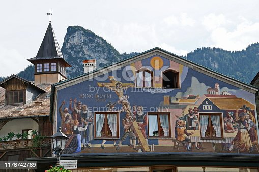 House with frescoes painting at the pedestrian zone of Oberammergau which is well known as home to a long tradition of woodcarving and for its famous Lüftlmalerei or frescoes.