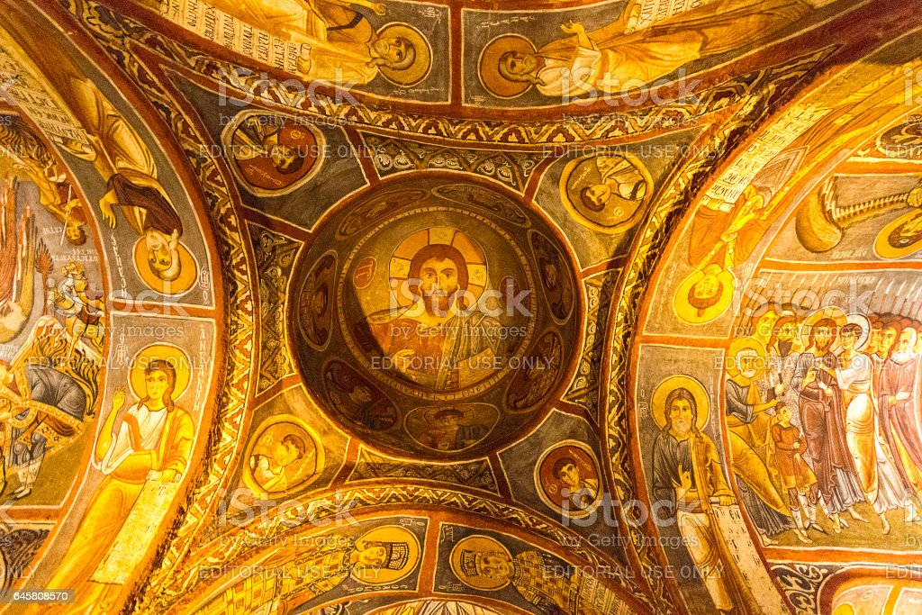 Cappadocia, Turkey - May 18, 2014: Frescos and architecture of the Dark Church in Cappadocia, Turkey. Dark Church is one of the rock cut churches built in the 11th century and its frescos represent biblical scenes. stock photo