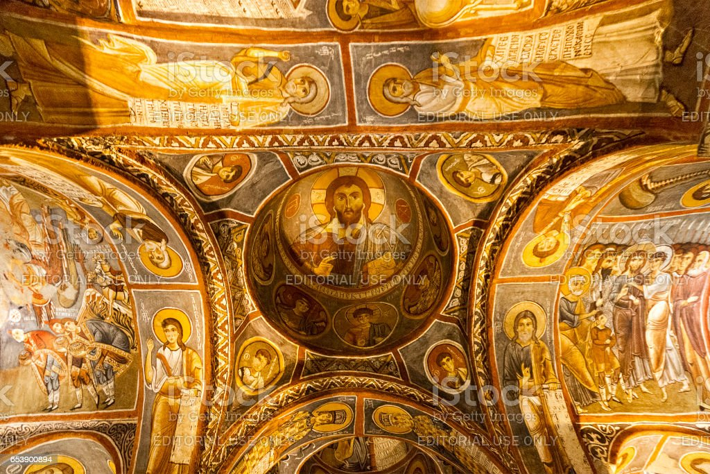 Cappadocia, Turkey - May 19, 2013: Frescos and architecture of the Dark Church in Cappadocia, Turkey. Dark Church is one of the rock cut churches built in the 11th century and its frescos represent biblical scenes. stock photo