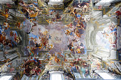 Paintings and frescos on the ceiling of a catholic church in Rome, Italy