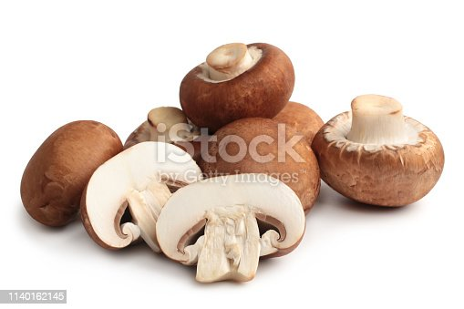 Fresh agaricus bisporus or portobello mushrooms on white background