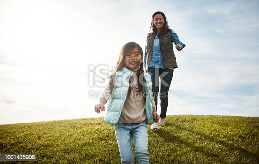 Shot of an adorable little girl out for a walk with her mom