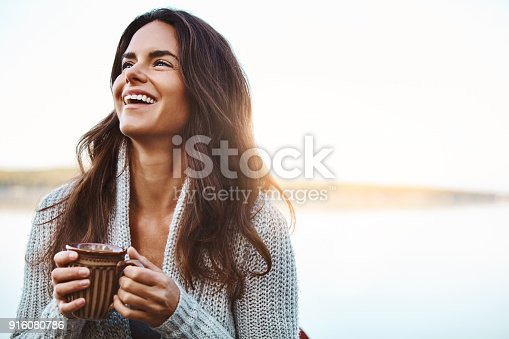 Shot of an attractive young woman relaxing while on vacation