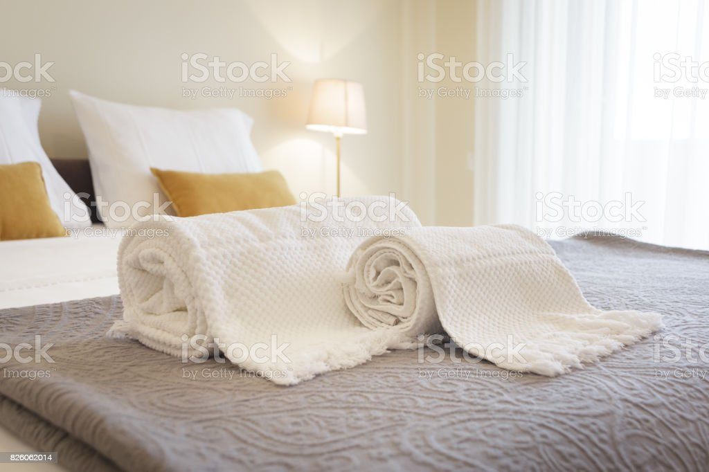 Fresh and clean towels in a bright room stock photo