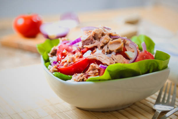 Fresh and colorful tuna salad Salad with tuna fish and vegetables, fresh and colorful. tuna animal stock pictures, royalty-free photos & images