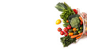 istock Fresh and colorful vegetables inside eco bag on white 1178524865