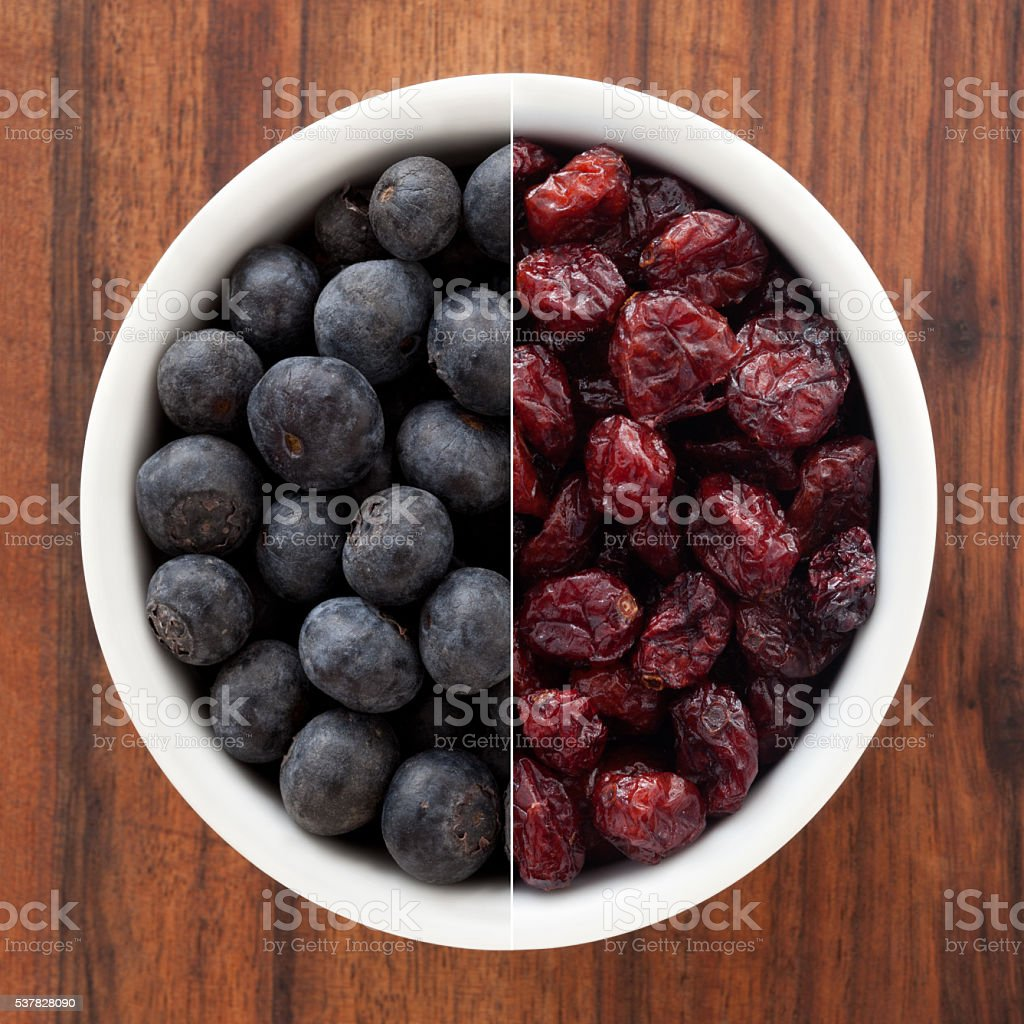 Fresh and dried blueberries stock photo