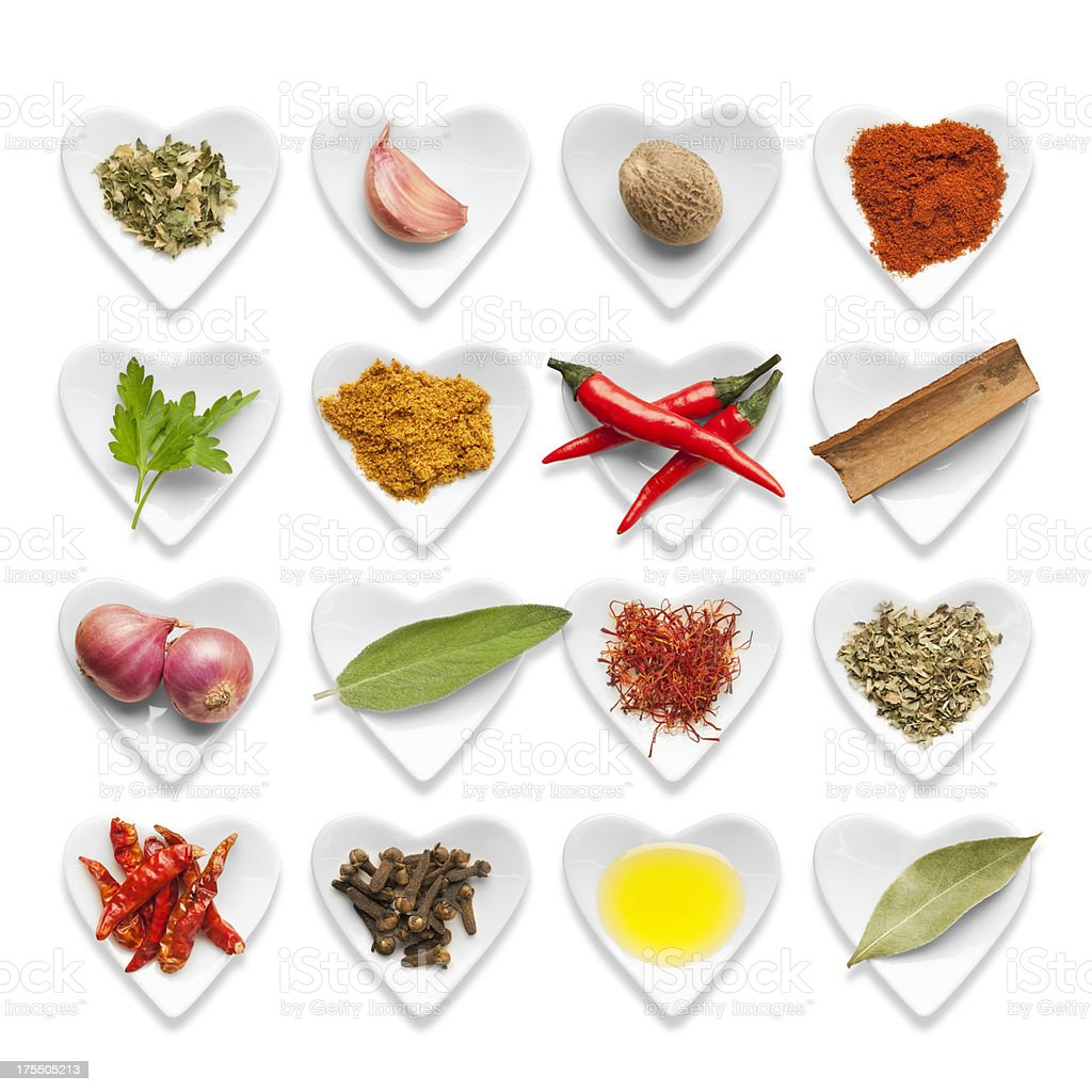 Fresh Italian cooking Ingredients served in small white heart shaped...