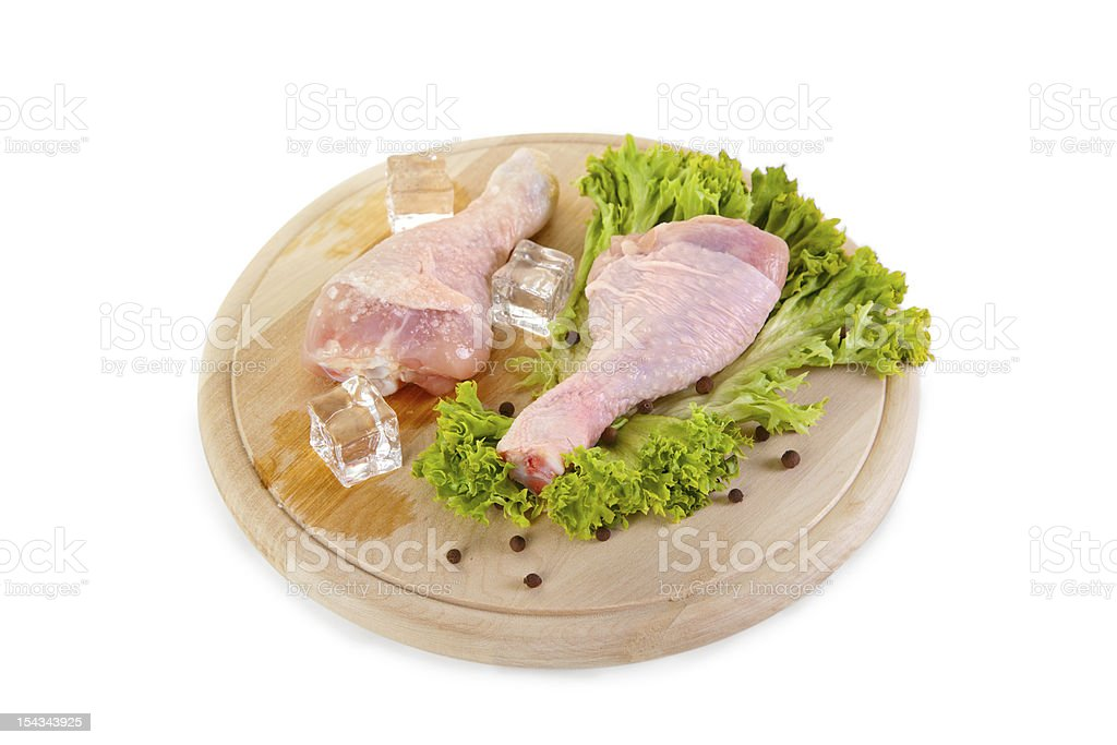 Fresh and frozen chicken legs with green salad royalty-free stock photo