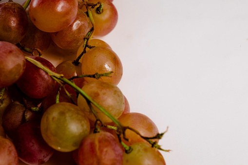 Fresh and healthy lucky grapes with space for text on white background