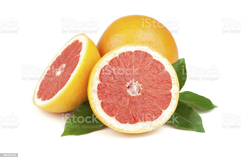 Fresh and juicy grapefruits on a white background royalty-free stock photo