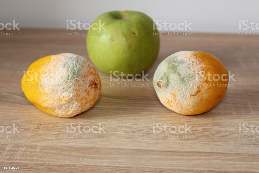 Fresh and molden fruits. stock photo