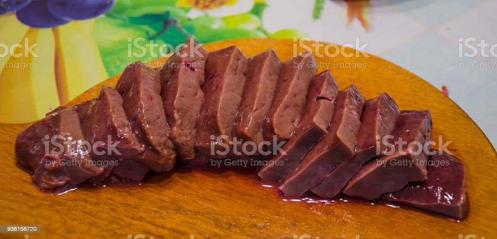 fresh and raw liver on white background stock photo