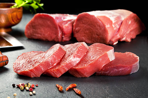 Fresh and raw meat. Sirloin medallions steaks Fresh and raw meat. Sirloin medallions steaks in a row ready to cook. Background black blackboard pork stock pictures, royalty-free photos & images