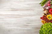 Fresh and raw vegetables on wooden kitchen table - Copy Space