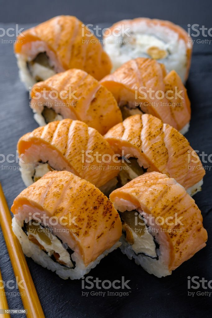 Fresh and tasty traditional Japanese sushi rolls close up. стоковое фото