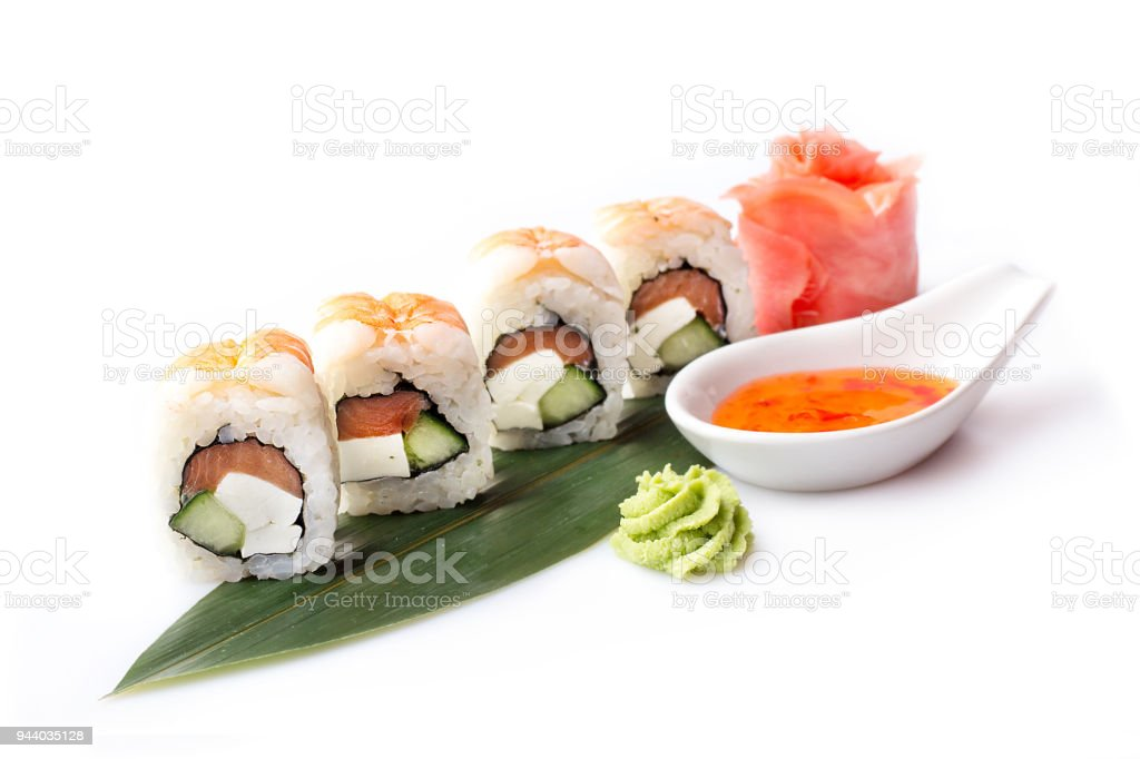 A fresh appetizing set of sushi rolls with shrimp laid out on a...
