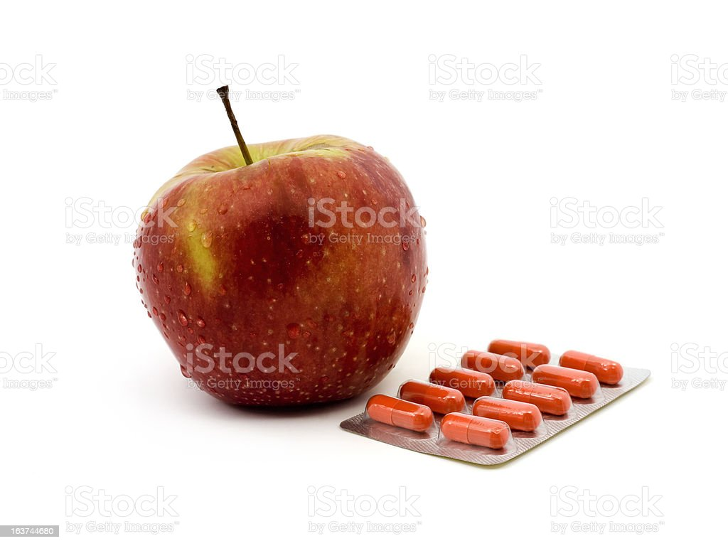 Fresh apple and Medicines royalty-free stock photo