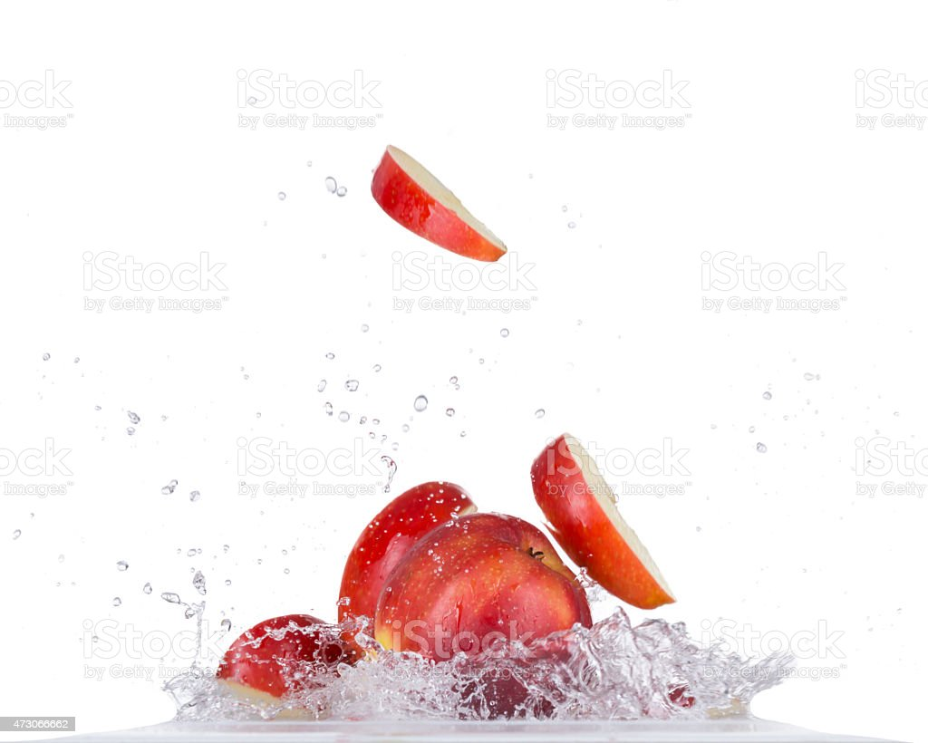 Fresh apple in water splash on white backround stock photo