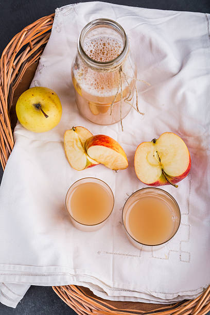 Fresh apple juice in a bottle and in a glass stock photo