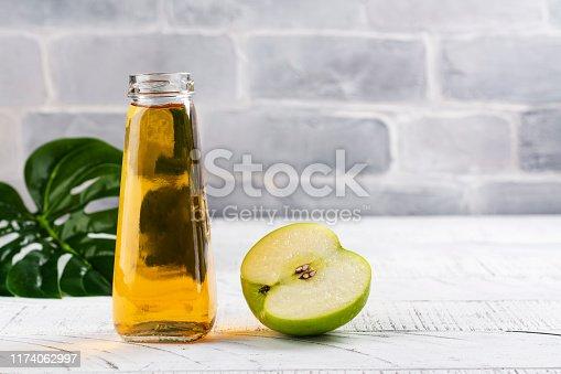 istock Fresh apple juice in a glass bottle 1174062997