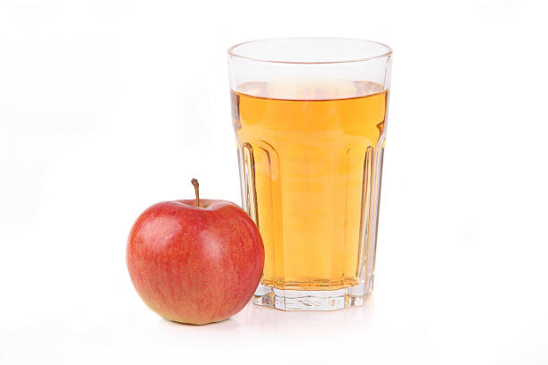 Fresh apple juice Fresh apple juice - studio shot isolated on white hot apple cider stock pictures, royalty-free photos & images