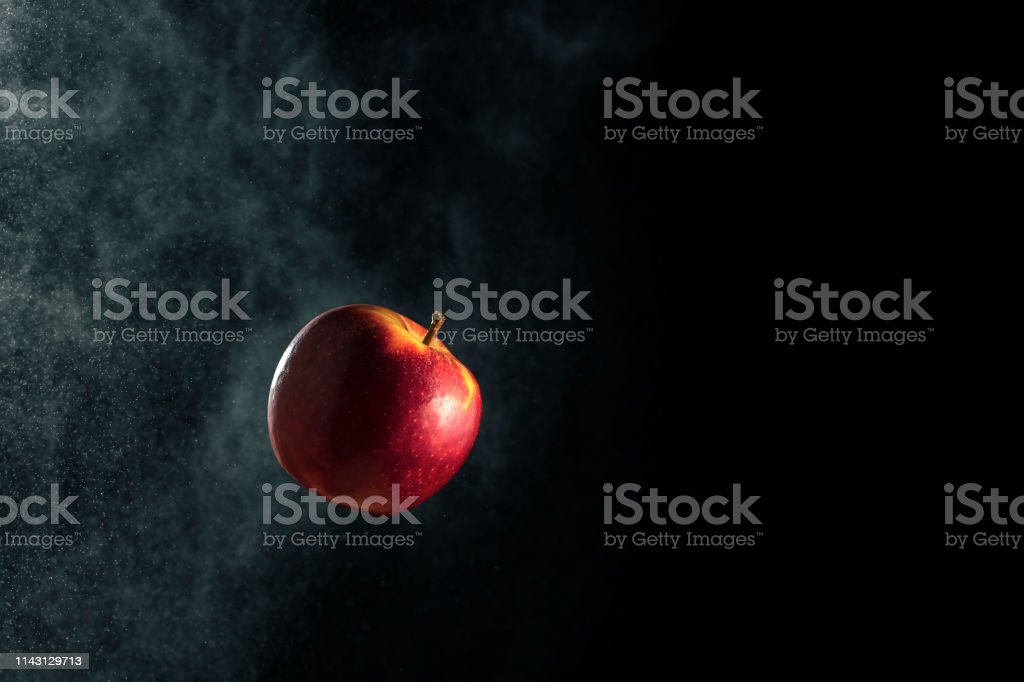 Fresh apple red-yellow on black gradient background