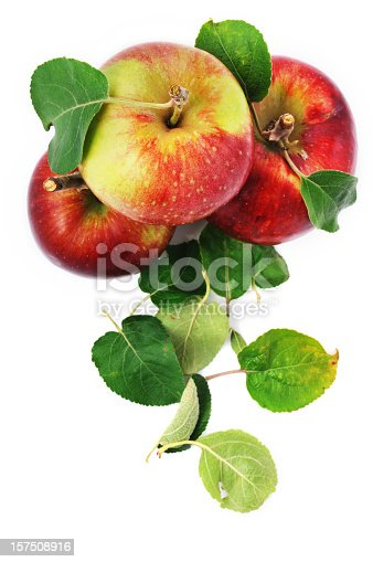 istock Fresh apples and scattered leaves isolated on white 157508916