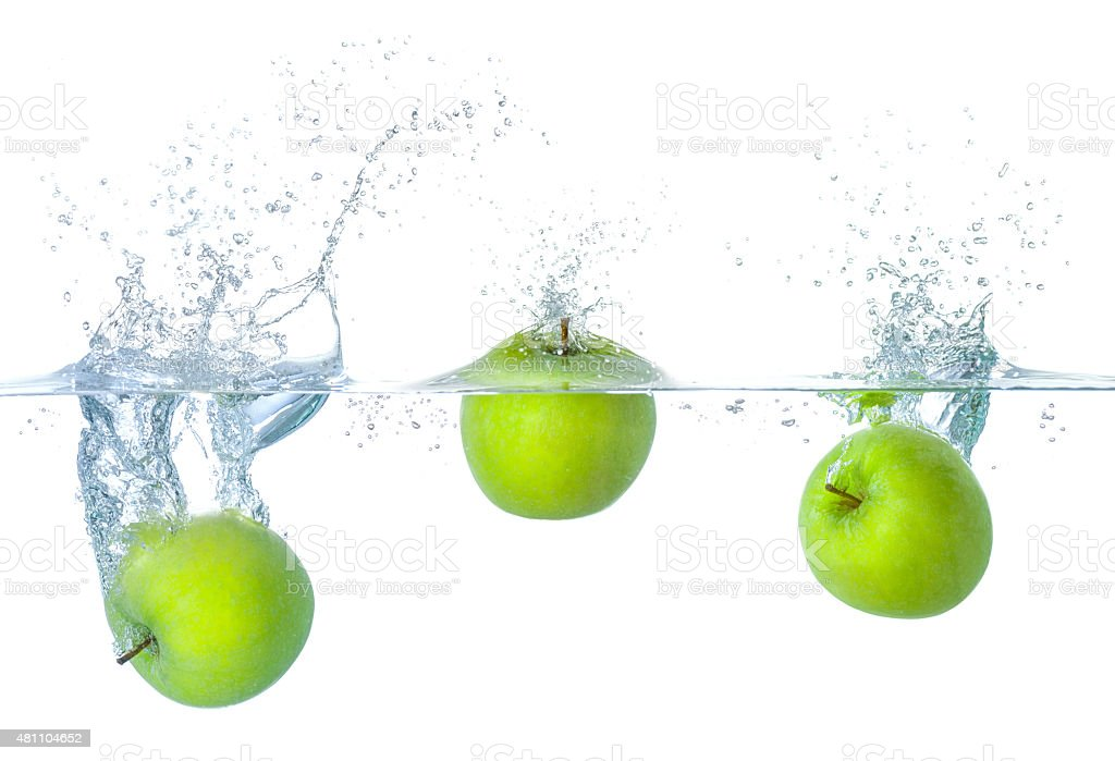 Fresh apples falling into water with splashes stock photo