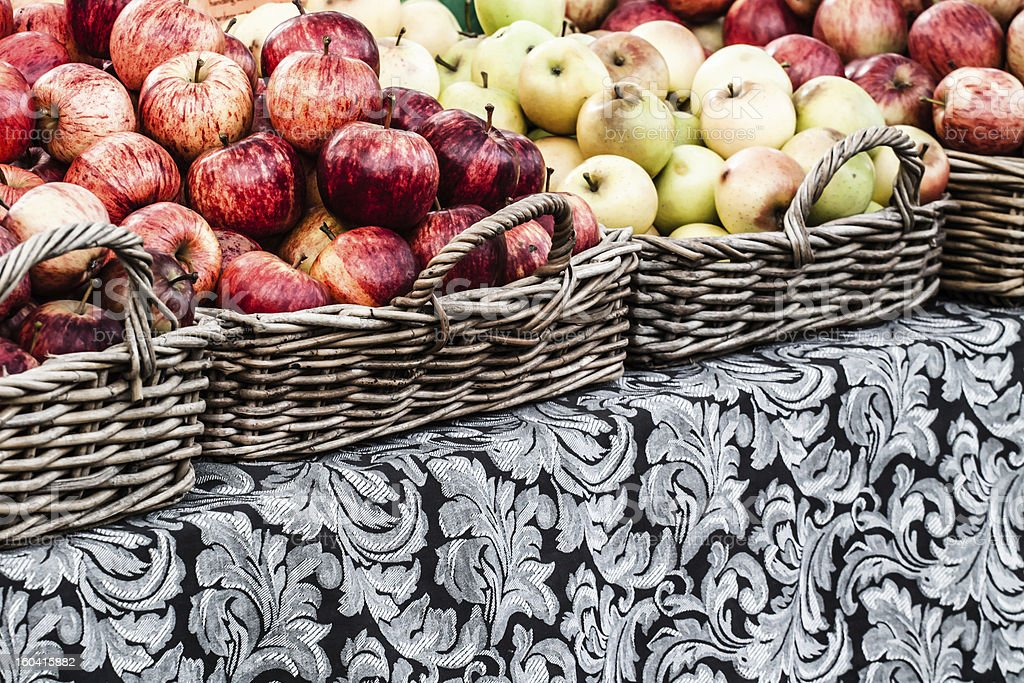 Fresh apples in baskets on display at a farmer's market royalty-free stock photo