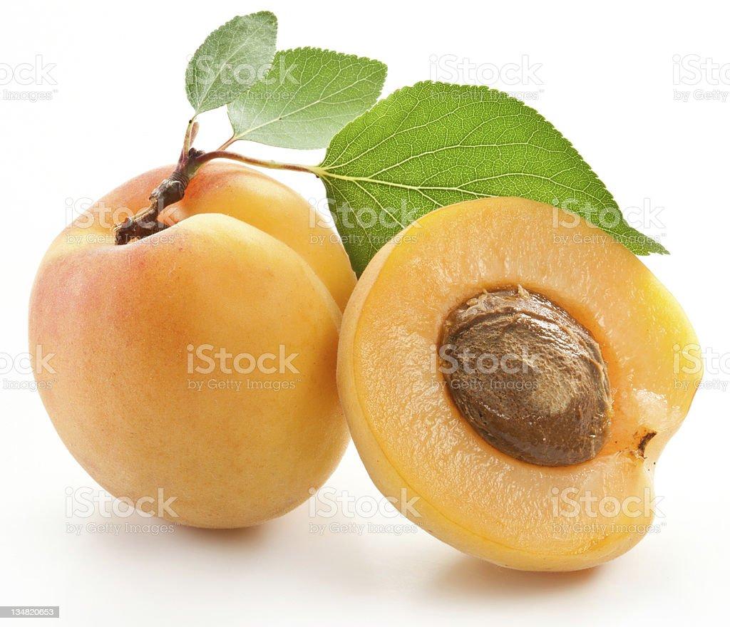 Fresh apricot next to half an apricot stock photo