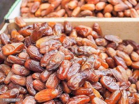 978314900 istock photo Fresh arabic dates or date palm fruit. 1189168501