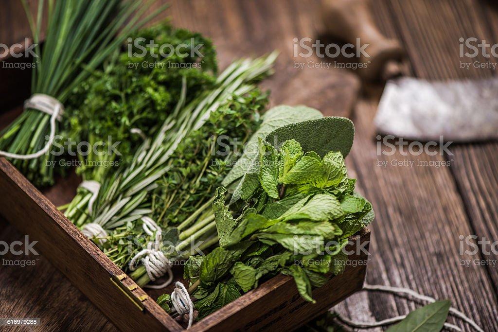 fresh aromatic herbs on kitchen table stock photo