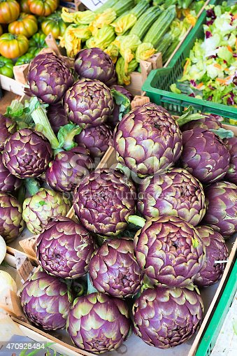 Fresh artichokes on display on a market in Italy
