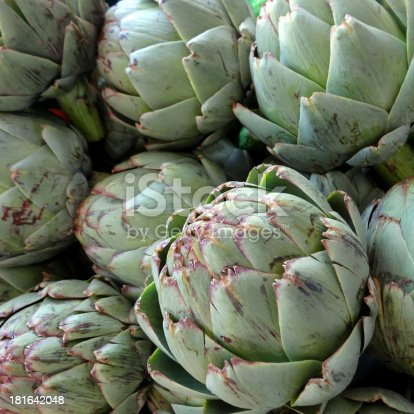 Square shot of fresh artichokes at a market