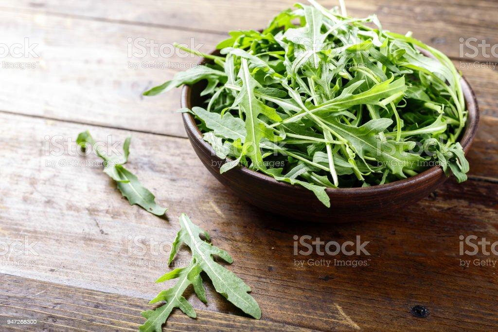 Fresh arugula leaves rucola, fresh rucola  in a plate stock photo