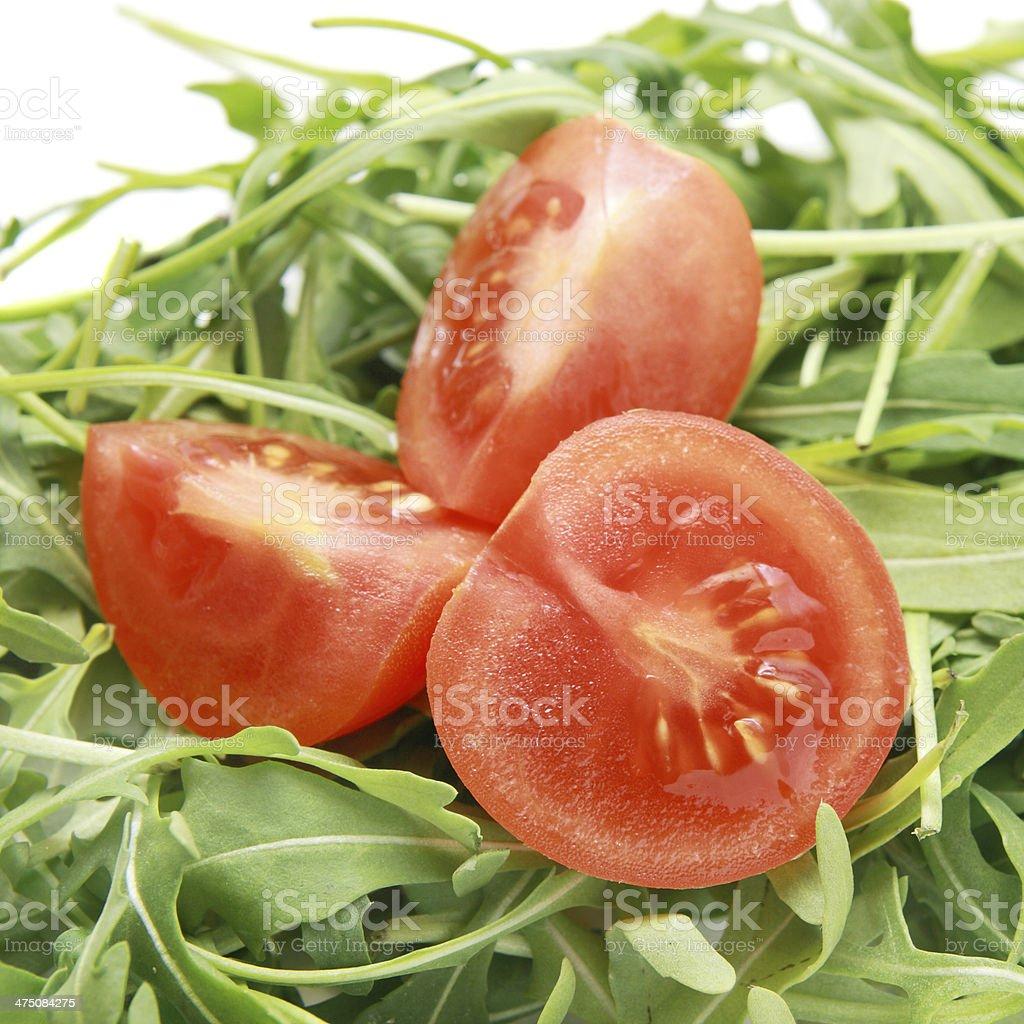 Fresh arugula with tomatoes salad. stock photo