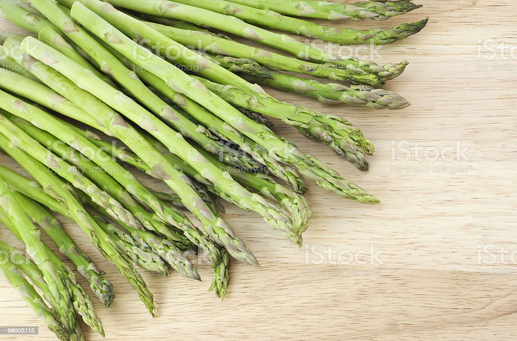 Fresh Asparagus on Cutting Board royalty-free stock photo