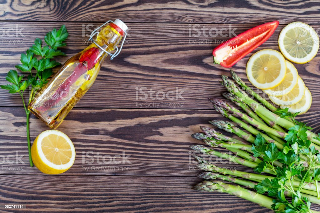 Fresh asparagus on wooden background royalty-free stock photo