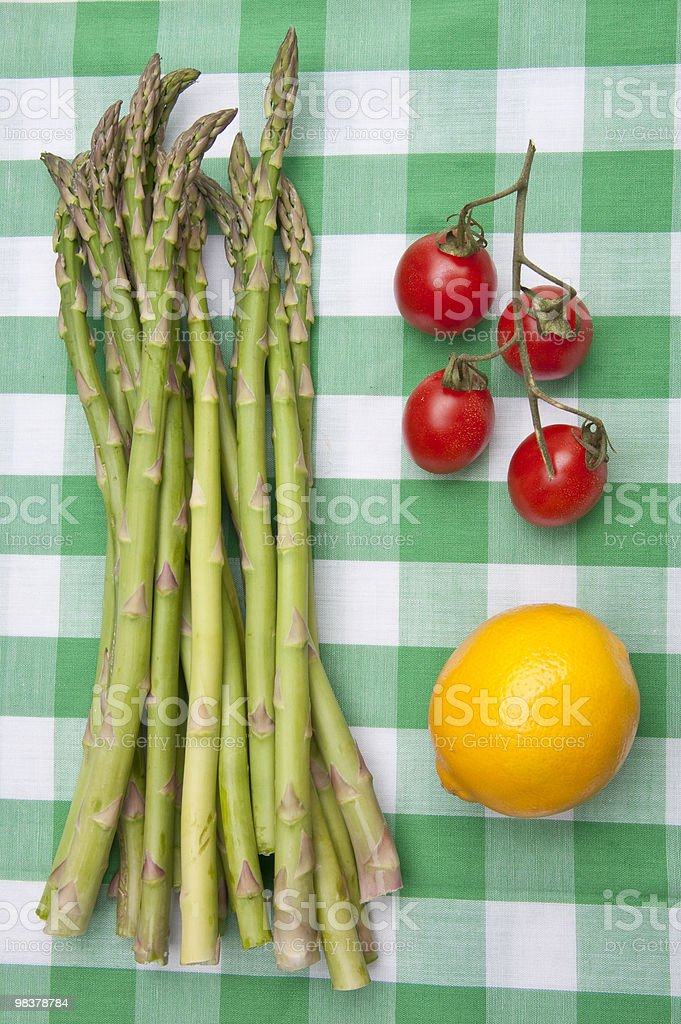 Fresh Asparagus with Lemon and Tomatoes royalty-free stock photo