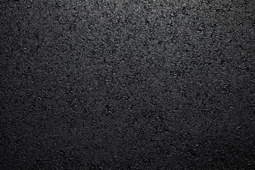 Background of freshly put asphalt on road.